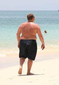 Overweight Man on Beach